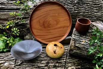 Four wooden bowls shown from above.